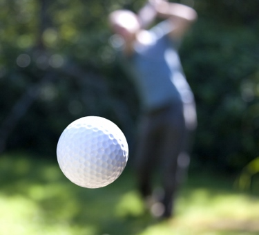 Golf ball flying